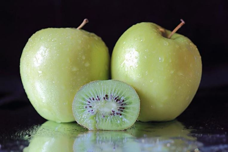two apples and a kiwi fruit still life by angela murdock