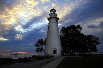 Lighthouse at Sunrise: Photography by Angela Murdock